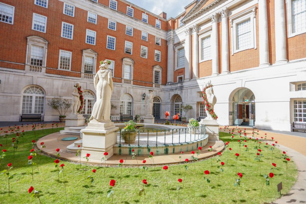BMA house Alice in wonderland secret garden Flamingos red roses pink carnations coral orange croquet statues