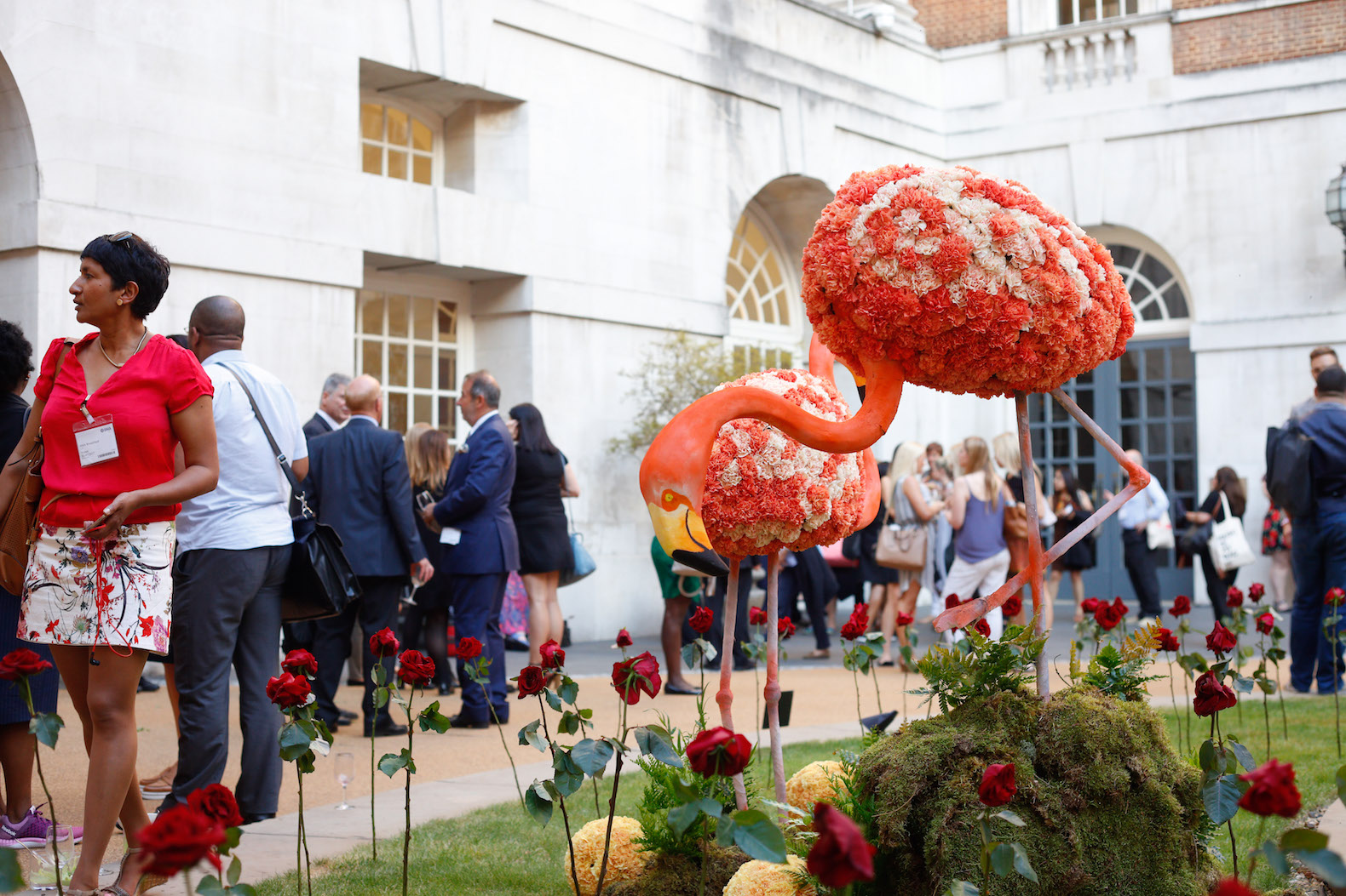 BMA house Alice in wonderland secret garden Flamingos red roses pink carnations coral orange croquet