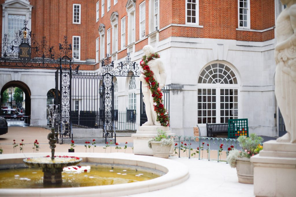 BMA house Alice in wonderland secret garden Flamingos red roses pink carnations coral orange croquet statues playing cards water feature