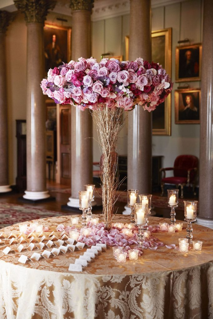 Goodwood wedding london venue table piece petals tealights votives candles flowers florists Larry Walshe