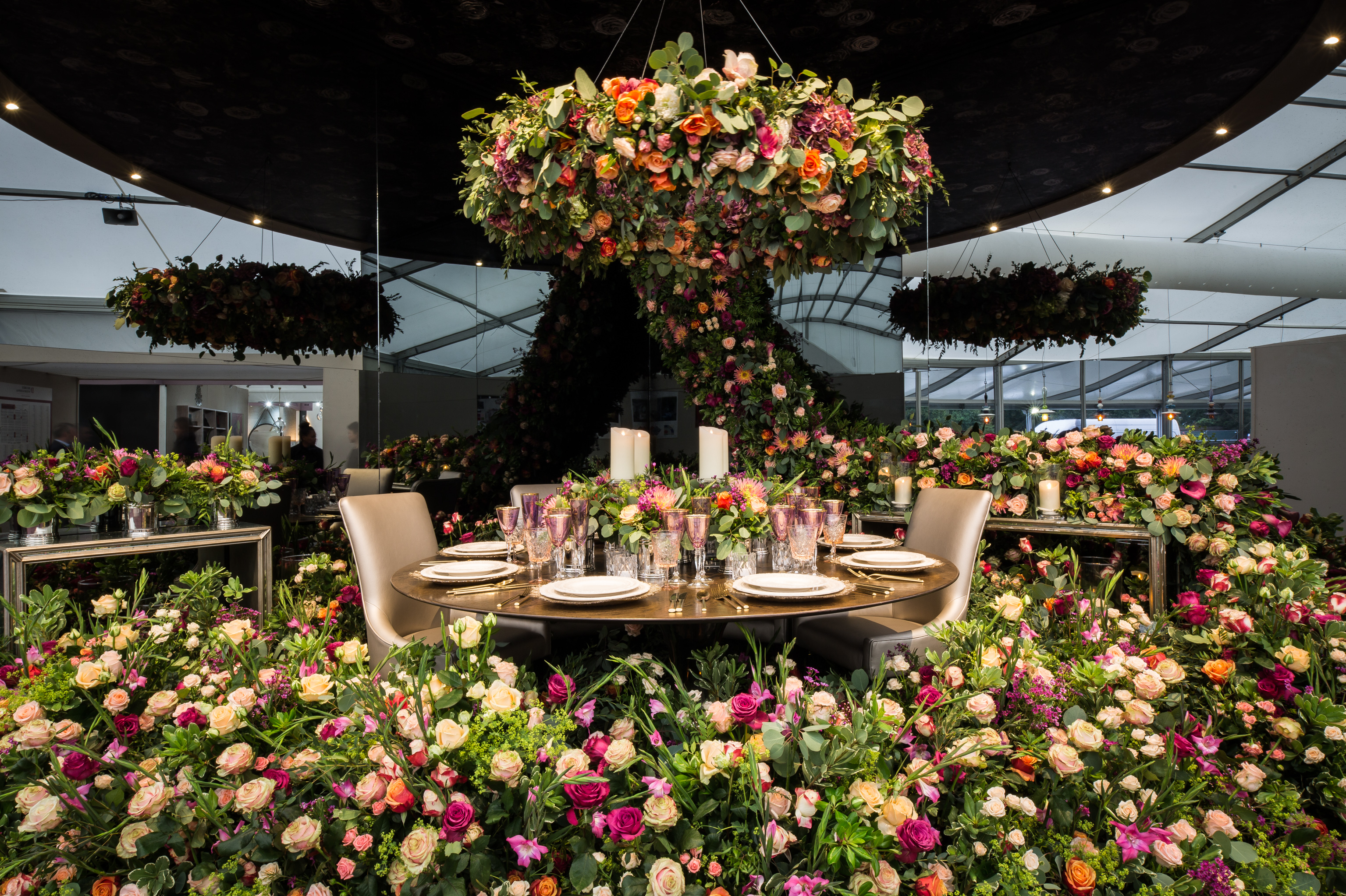 Larry Walshe Flowers Decorex International Main Entrance Chandelier Flower Foliage Carpet Table Setup Dinner Service Glassware Candles Flowers Florist London