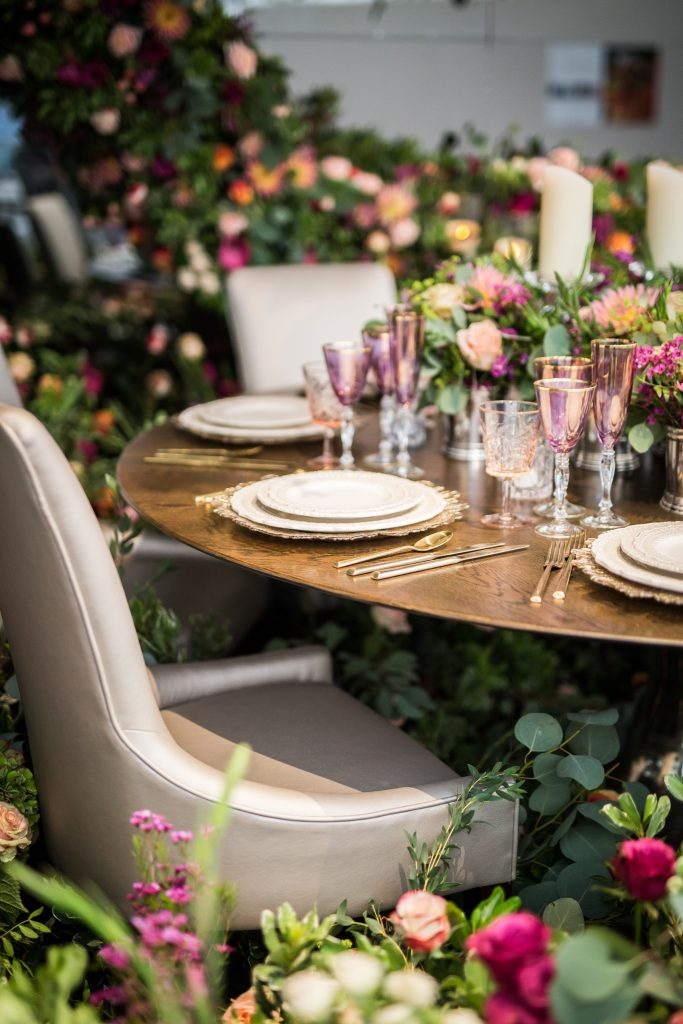Larry Walshe Flowers Decorex International Main Entrance Flower Foliage Carpet Table Setup Dinner Service Glassware Candles Flowers Florist London